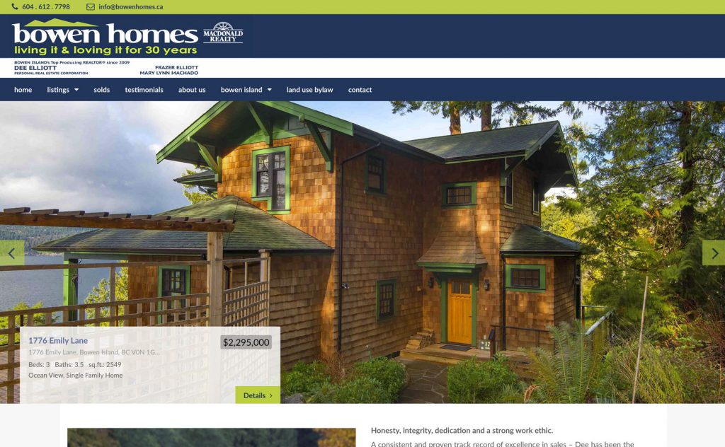 The home page of Bowen Homes, featuring a large image of a cedar shake house with a green metal roof overlooking the ocean.